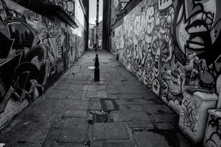 Barry Hurley; Paint Alley, 2018, Original Photography Black and White, 24 x 16 inches. Artwork description: 241 An Alley from the East End of London. Originally whitewashed, the locals added their own touch...