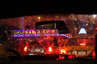Barry Greff; Cab Ride In The Rain Nyc, 2009, Original Photography Color, 22 x 17 inches. Artwork description: 241 For the viewer to feel the experience of being in the back seat of a New York City Taxi Cab during rush hour with a light rain passing Radio City Music Hall. ...