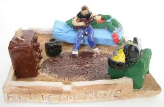 Bobbie Newman; For Love And Music, 2005, Original Sculpture Ceramic, 5 x 2 inches. Artwork description: 241 Figrue of a Young man alone in a one room apartment playing guitar with guitar case open in corner. Not luxurious surroundings. Glazed and Stained white clay...
