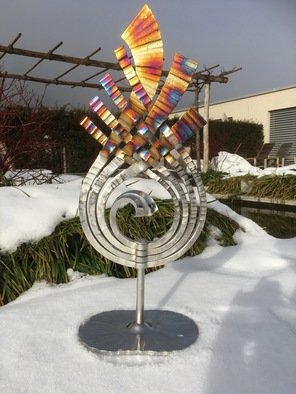 Claudio Bottero; Fiamma, 2018, Original Sculpture Steel, 40 x 80 cm. Artwork description: 241 A unique piece that was inspired by the beauty of fire. The piece is coloured using heat after the Stainless steel has been electro polished. It is suitable for outside. ...
