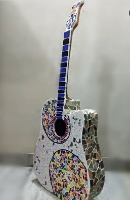 Radha  Chaudhary; Guitar, 2019, Original Mosaic, 1.5 x 3 feet. Artwork description: 241 It s a mosaic.  I used my old wooden guitar which was not in use. . . . .  I m a music lover soo i choose to make mosaic of my old guitar.  I have used tiles to make the same. . . .  this is for all the music and guitar lovers ...