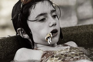 David Lorenz Winston; Doll In Mouth, 2006, Original Photography Color, 20 x 14 inches.