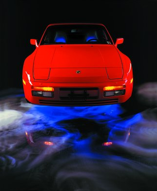 David Plank; Porsche 944, 1986, Original Giclee Reproduction, 13 x 18 inches. Artwork description: 241  Studio photography of 1984 Porsche 944 on 4x5 transparency film. . Concept. Floating. Giclee reproduction ...