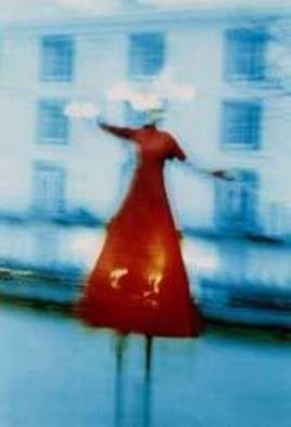 Andrew Stanford; The Balance Of Red, 2004, Original Photography Color, 16 x 20 inches. Artwork description: 241 Christmas festival at Tunbridge wells U. K In the cold winter light a figure dances on stilts....