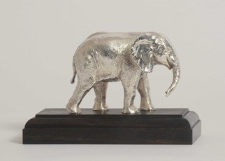 Heinrich Filter; Elephant In Sterling Silver, 2013, Original Sculpture Other, 14 x 9 cm. Artwork description: 241 Baby elephant sculpture in Sterling silver on ebony base by Heinrich Filter; Sterling silver weight approx 580grams; also available in bronze. ...