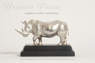 Heinrich Filter; Whit Rhino Silver Sculpture, 2013, Original Sculpture Other,  13 cm. Artwork description: 241  White Rhino sculpture in Sterling silver on ebony base; length 18 cm x height 13 cm inclusive of base; approx. silver weight 1100 grams; also available in bronze ...