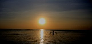 Glen Sweeney; A New Day, 2017, Original Photography Color, 94 x 45 cm. Artwork description: 241 The sun rising over the coastal sea of Bali. Bali, sunrise, fishing boat, dawn...