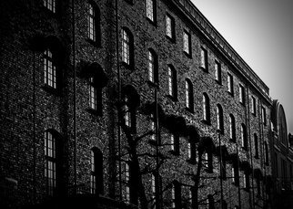 Glen Sweeney; Brickworks, 2019, Original Photography Black and White, 53 x 45 cm. Artwork description: 241 A converted warehouse in Bergen Norway.  The backlight emphasises the wonderful texture of the bricks.  Bergen, Norway, bricks, warehouses. ...