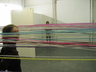 Carly Munro; Alltiedup, 2005, Original Installation Indoor, 15 x 5 m. Artwork description: 241  Woolen ceiling exactly my height and the national adverage of women. 5'3. Anyone unfortunate to be tallen had to duck and dive between gaps in the wool to navigate the space. ...