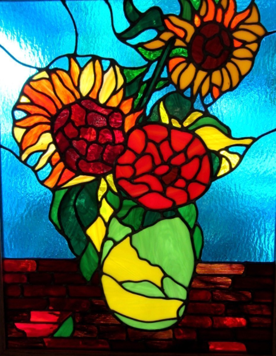 Iva Kalikow; Sunflowers, 2018, Original Glass Stained, 22 x 27 inches. Artwork description: 241 This leaded stained glass art panel is inspired by Vincent Van Gogh.  Van Gogh was mesmerized by sunflowers and I was inspired to capture this study in a vase with vibrant yellow, orange and green glass.  This glassart panel includes 325 hand- cut pieces of 15 different ...