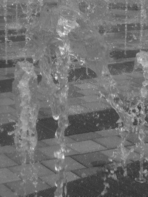 Jeanette Locher; Upward Water, 2008, Original Photography Color, 12 x 18 inches. Artwork description: 241  I took this along the riverwalk in Detroit- they have these fountains of water that the kids play in, it was windy that day and the water looked like it was flowing up- hence the title of the photo ...
