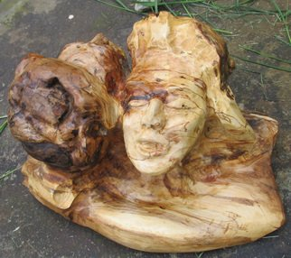 John Clarke; Reunion, 2015, Original Sculpture Wood, 20 x 11 inches. Artwork description: 241 Two faces, dark and light, in two connected cherry burls...