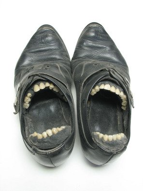 Jill M. Armstrong; Duet, 2004, Original Sculpture Mixed, 7 x 9 inches. Artwork description: 241 A pair of women' s shoes fitted with a set of porcelain teeth from a denturist...