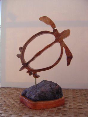 Joel P Heinz Sr.; Petroglyph Honu, 2007, Original Sculpture Wood, 9 x 13 inches. Artwork description: 241  Honu is carved from Hawaiian Koa and is mounted on a lava and Koa baise. Petroglyphs are carved into the lava. ...