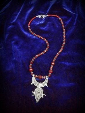 Judith Mitchell; Mythogems VIII, 2012, Original Beads,  27 cm. Artwork description: 241  An antique Tuareg sterling pendant with the crescent moon; dark blood- red carnelian beads and sterling beads like stars. This is worthy of Scheherazade' s jewel- chest. ...