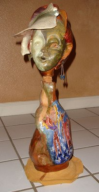 Kanika Marshall; Looking Back On My Life, 2000, Original Ceramics Handbuilt, 11 x 22 inches. Artwork description: 241  Best of Show in 2000.  The swiveling head can look toward the back face onto three women dancing under the sun and on top of stars. Clay, leather, marbles.  ...