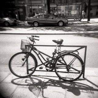 Karen Morecroft; A Bicycle In Paris, 2009, Original Photography Black and White, 5 x 5 inches. Artwork description: 241  A bicycle on the city streets of Paris, France. Photo mounted on black card ( approx 6x8) ...