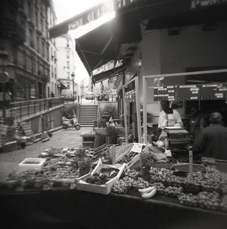 Karen Morecroft; Fruit Seller In Paris, 2009, Original Photography Black and White, 5 x 5 inches. Artwork description: 241  A grocer on the streets of Paris, France selling fruit and other goods. Photo mounted on black card ( approx 6x8)  ...