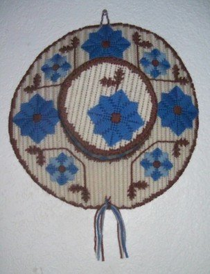 Kathie Freeman; Country Cover, 2012, Original Fiber, 14 x 16 inches. Artwork description: 241  Blue and Beige Needlepoint HatThis lovely wall decor is worked over plastic canvas and measures 14 inches in diameter. Perfect for bedroom or family room ...
