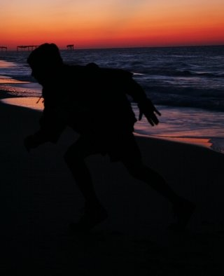 Kristine Caroppoli; Mercury Rising III, 2010, Original Photography Color, 8 x 10 inches. Artwork description: 241  Caroppoli, digital photograph, photo, photography, image, picture, figure, figurative, silhouette, color, motion, mercury, rising, running, run, greek, god, raise, determination, strength, beach, colorful, brilliant, pulsating, energentic, vitality, spirit, spiritual, vivid, rich, vibrant, splender, human, body, soul, evocative, mythical ...
