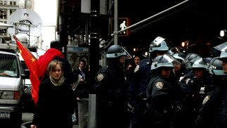 Kerwin Williamson; Occupy Wall Street, 2011, Original Photography Color, 30 x 20 inches. Artwork description: 241  This was one the morning when the NYPD closed off the area around the NYSE, allowing only people who work or live in & around the area in and out. I captured this image just at Wall street and Broadway. ...