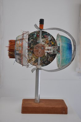Micha Nussinov; Scarecrow, 2010, Original Sculpture Mixed, 51 x 61 cm. Artwork description: 241   A double face with opposing spheres rotating on a pole. Made from recycled matters, wood, aluminume tube, plastic ricota draining dishes, colour mixing palate, wooden sticks, paint tube, acrylic spheres, epoxy, oil paint, screw, wires and. . . ...