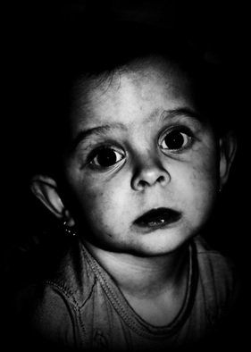 Maciej Wysocki; Julinka, 2013, Original Photography Black and White, 30 x 42 cm. Artwork description: 241 child, girl, eyes, black eyes...