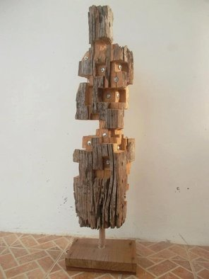 John Paul Dalisay; People Are People, 2011, Original Sculpture Wood, 1.5 x 3.8 feet. Artwork description: 241  Recycled old molave wood post   ...