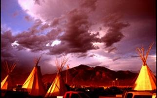 Paul Slaughter; Taos Pow Wow, 1997, Original Photography Color, 20 x 16 inches. Artwork description: 241 (c) Paul Slaughter-The Taos Pow Wow in the late eveningat Taos, New Mexico.  Available as a fine art print on Fujicolor Crystal Archive paper....