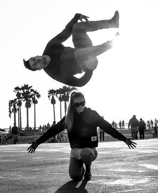 Dick Drechsler; The Flying Tourist, 2018, Original Photography Black and White, 11 x 14 inches. Artwork description: 241 This picture was captured in Venice, CA as a tourist was exhibiting his athletic skills. ...