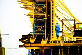 Richard Peterson; Bridge, 2019, Original Photography Color, 61 x 40 cm. Artwork description: 241 This photograph was taken in the Nile riverEgypt , worker on a brigde under construction. ...