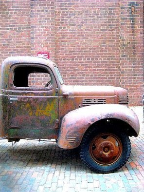 Ronnie Caplan; Truckin, 2014, Original Photography Color, 9 x 12 inches. Artwork description: 241 A retro, antique feeling emanates from this semi- dilapidated truck, parked on a field of cobblestones, as if fixed in time.  .  .  Antiquated and enduring, the vehicle still stands bold against a brick wall in an almost monochromatic composition that features dulcet hues of brown, ochre, rust, ash.  .  .  ...