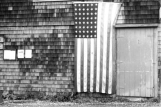 Ruth Zachary; Island Patriot, 2012, Original Photography Black and White, 10 x 8 inches. Artwork description: 241 Forty- eight star American flag displayed on rustic shaker shingled New England barn.  Monhegan Island, Maine.   ...