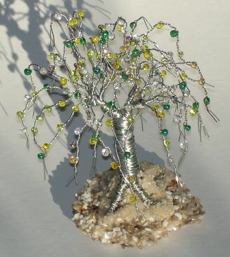 Sal Villano; beaded on beach sculpture, 2017, Original Sculpture Wire, 3.5 x 5 inches. Artwork description: 241 Beaded on Beach, Wire Tree Sculpture.5 H x 3. 5 W x 3. 5 D Made of  26 gauge galvanized steel wire with yellow, white, clear and green colored glass fringes beads that are wired onto each branch. The tree is mounted on a base of ...