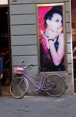 Susan Brannon; Advertising On A Wall, 2012, Original Photography Color, 11 x 14 inches. Artwork description: 241    Florence, Italy, advertisement, fashion, poster, woman, surprised,  bicycle, artwork on wall, cityscape, beard, hat, pick bicycle, life, documentary, culture,  photography, susan brannon          ...