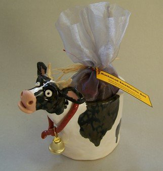 Suzanne Noll; Cow Potpourri Vase Item  V1079, 2011, Original Sculpture Ceramic, 4 x 7 inches. Artwork description: 241        Moooooo- ve over Cow lovers, this ceramic cow potpourri vase comes with a bag of Apple Cider Potpourri to be both a great for decoration as well as filling your or a friends home with a pleasant fragrance. I added a little bell to the cow's ...
