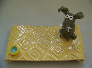 Suzanne Noll; Gray Dog Post It Note Holder, 2011, Original Ceramics Other, 1.5 x 12 inches. Artwork description: 241       This cute little dog is sitting on a cream colored base plate with a water dish on the opposite side. This is a fun and whimsical, decorative plate that can be used to hold post- it notes, change or other small items. He is made of high ...