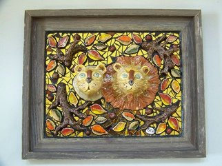 Suzanne Noll; Lions Pride, 2009, Original Sculpture Mixed, 15 x 15 inches. Artwork description: 241        Lion's Pride is a high fired, ceramic, Lion & Lioness mask of various glazes. They are inlaid in handmade tiles, gold mirror and broken glass inside of a barnwood frame. The whiskers are of gold toned wire and gold toned balls at the ends.As with all ...