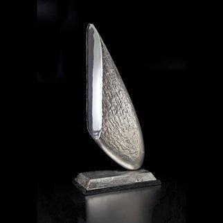 Ted Schaal; Sliver, 2013, Original Sculpture Steel, 16 x 31 inches. Artwork description: 241 This piece was inspired by an article I read about an asteroid that is speculated to be 100 stainless steel.  This is a Sliver of that asteroid that plummeted to Earth and then sliced and polished. ...
