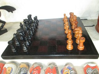 Dimitri Sonkeng; Chess table made with ebo..., 2015, Original Sculpture Wood, 35 x  cm. Artwork description: 241  original chess table made by a cameroonian artisan, with ebony wood and red wood ...