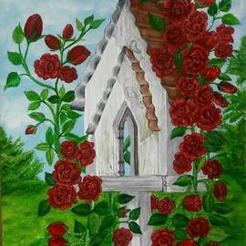 bird house with climbing roses