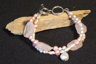 Anna Peterson: 'Rosie pearl', 2007 Jewelry, Fashion.   Shades of pink cultured freshwater pearls surround four rose quartz nuggets in this double stranded bracelet.  Sterling silver balls add shine to this mix with a pewter toggle clasp.  ...