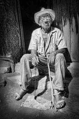Andrew Xenios: 'Lorenzo, a Mayan at 100 yrs old', 2012 Black and White Photograph, Representational. Artist Description:  This is Lorenzo, he is a Mayan living in a mud walled thatch roofed house he built himself 85 years earlier.  ...