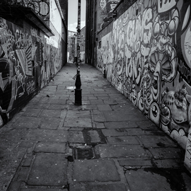 Barry Hurley: 'paint alley', 2018 Black and White Photograph, Urban. Artist Description: An Alley from the East End of London. Originally whitewashed, the locals added their own touch...