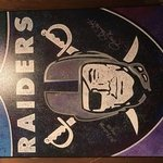raiders team logo autographed By Bill Lopa