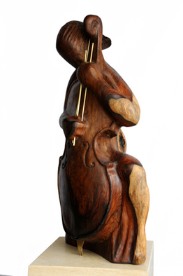 Wood Sculpture by Tzipi Biran titled: The player, created in 2012