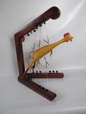 Bill Czappa: 'spring chicken', 2015 Mixed Media Sculpture, Humor. This is another of those works tht is  play on words. The rubber chicken is held in balance with springs and wire. The guitar tuning knobs add a great dimension to the piece making it look a bit like a musical instrument. I am reselling this for my collector. ...