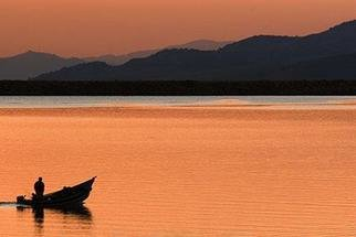 David Lorenz Winston: 'Boat on Emigrant Lake at Sunset', 2005 Color Photograph, Marine. Fisherman and boat heading back to dock....
