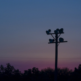 Dion Mcinnis: 'Dusk Lights', 2007 Color Photograph, Sky. Artist Description:  Light poles in front of sunset sky.  Print comes mounted in window mat. ...