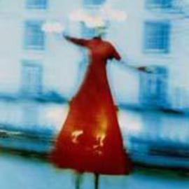 Andrew Stanford: 'The balance of red', 2004 Color Photograph, Theater. Artist Description: Christmas festival at Tunbridge wells U. K In the cold winter light a figure dances on stilts....